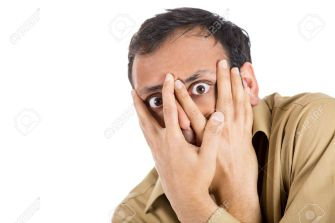 25792771-Closeup-portrait-of-anxious-guy-paranoid-man-covering-his-face-with-hands-looking-through-fingers-ha-Stock-Photo.jpg